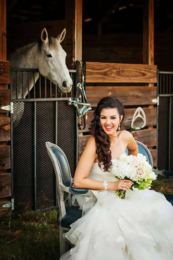 Bride at the stable with a horse
