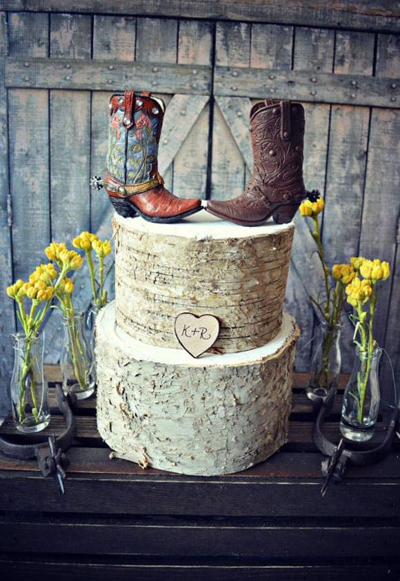 Rustic wedding cake with cowboy boot toppers