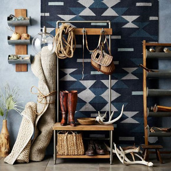 Rustic entryway with hanging rug
