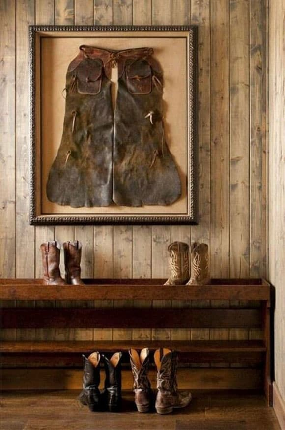 Western entryway with chaps in a shadowbox