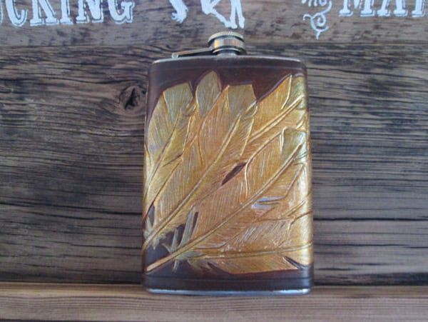 Leather flask with gold feathers