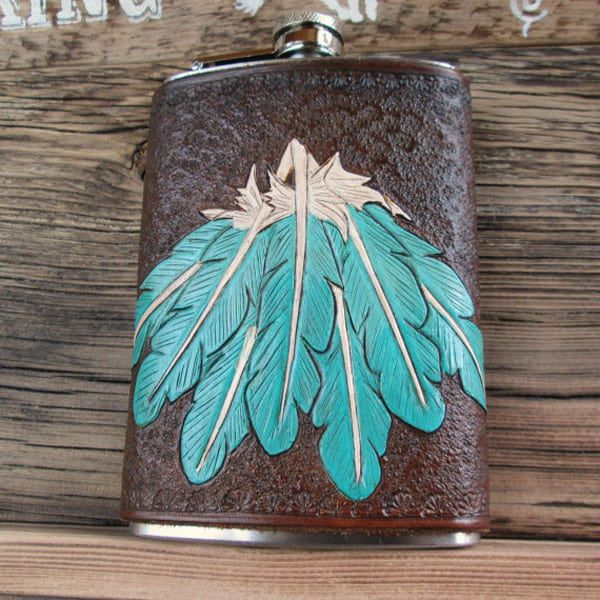 Leather flask with turquoise feathers