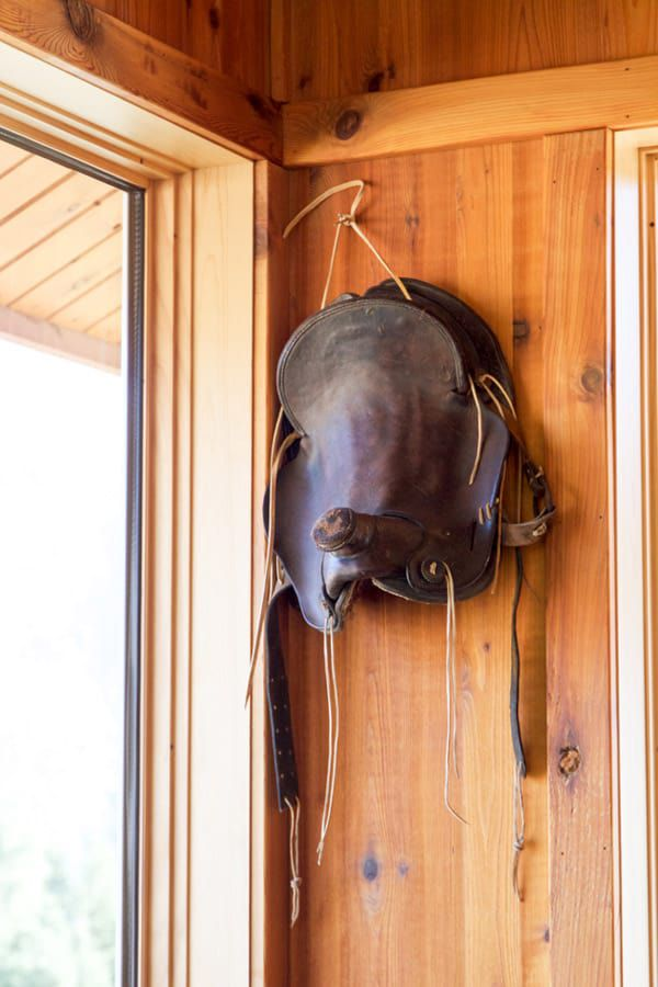 An-old-western-saddle-hanging-on-the-wall