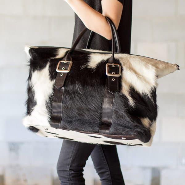 Cowhide-buckle-duffle-bag
