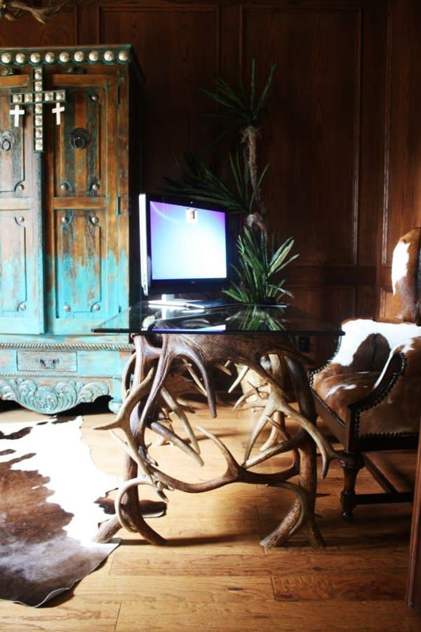 Cowhide-chair,-rug,-and-antler-desk