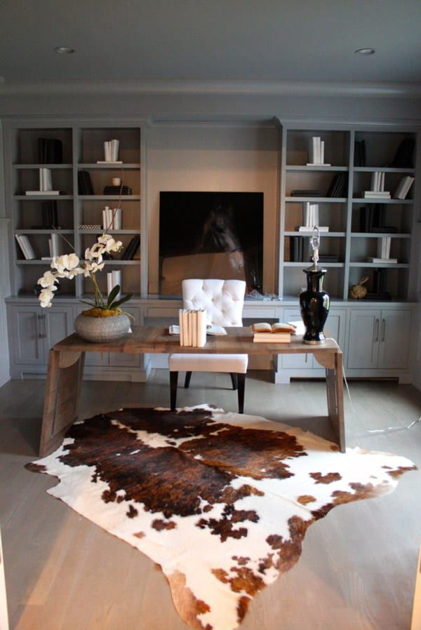 Large-cowhide-rug-in-office-with-horse-art