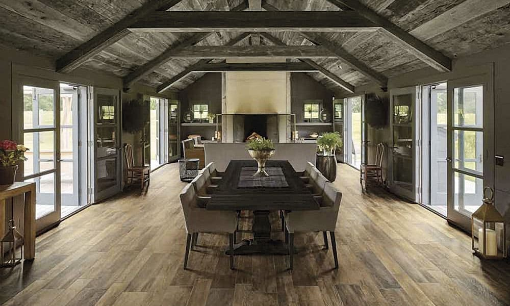 Wood-look tile gives the appearance of classic or reclaimed hardwood floors, but with the lower maintenance and scratch resistance of ceramic or porcelain.