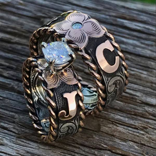 b bar j custom designs Preston Johnson silver silverware silversmith engrave engraving tooled tolling metal yeti cross necklace cross pendent phone case money clip cowgirl magazine