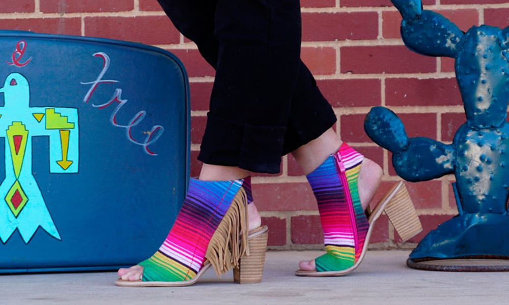 very volatile serape fringe bootie rolling ranch boutique cowgirl magazine