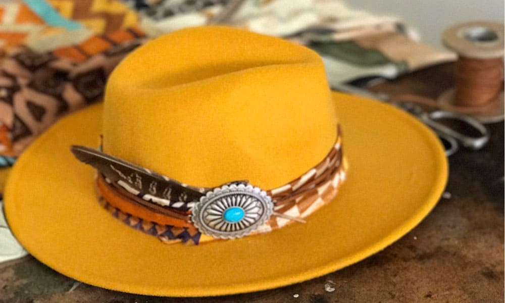 Bone X Dawn yellow hat with hat band and feather, Cowgirl Magazine