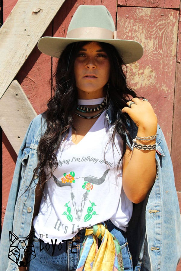 The Coyote Cowgirl It's Livin white graphic tank cowgirl magazine