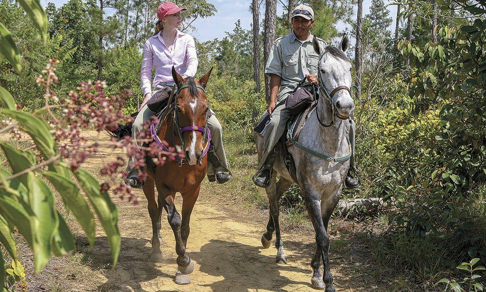Belize Darley Newman Horseback Riding Cowgirl Magazine