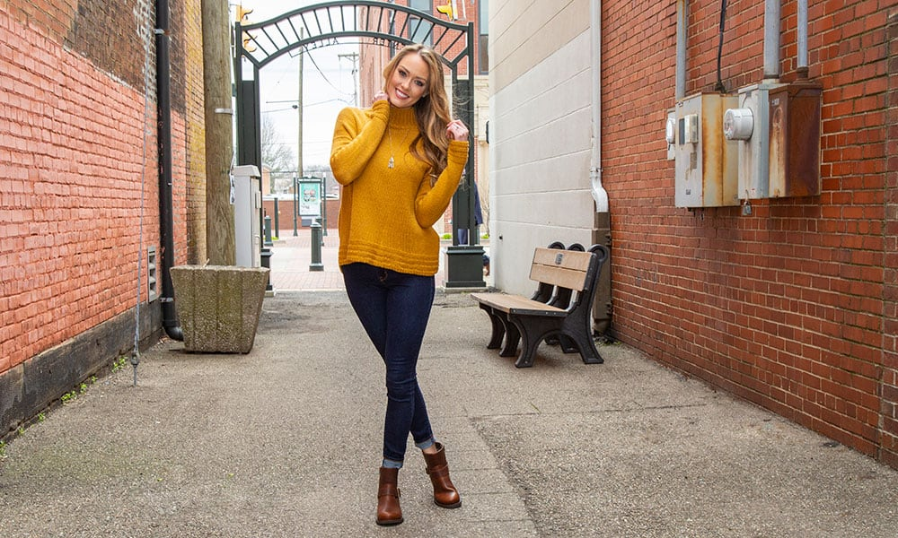 durango brown crush booties girl with yellow sweater jeans alleyway