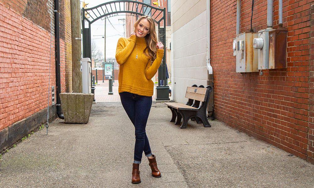 durango brown crush booties girl with yellow sweater jeans alleyway