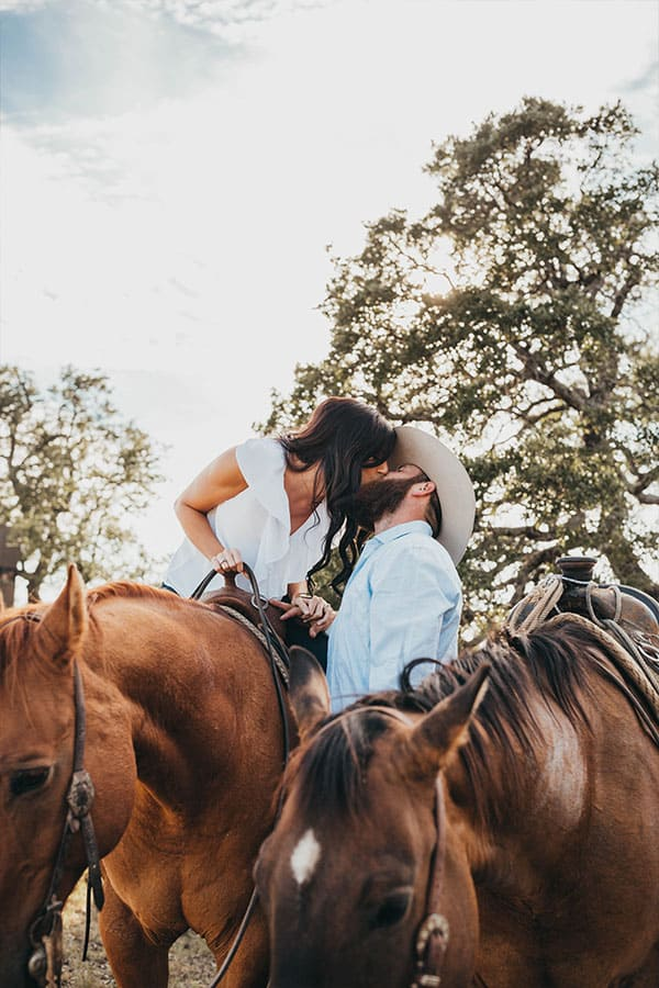 photographer cowgirl magazine Madi Wagner horses kissing kiss kisses couple in love