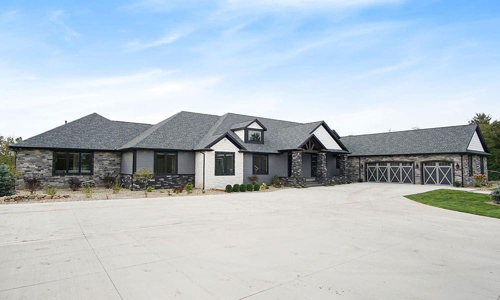 sprawling acreage cowgirl magazine home house grey brick white brick landscape barn house