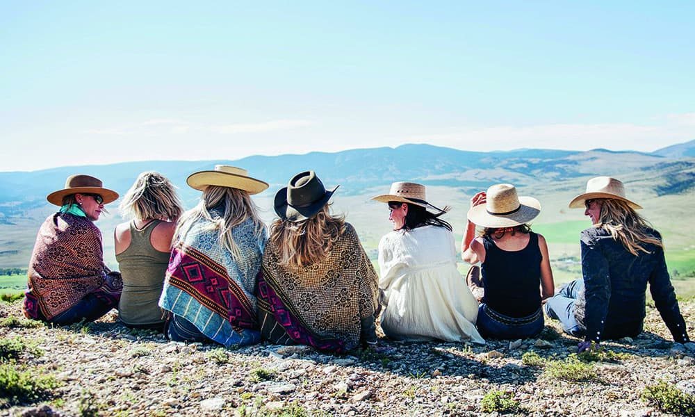 cowgirls ponchos horse ride rocks cliff cowgirl magazine