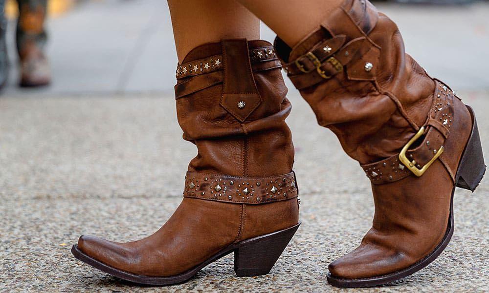 brown boots on a grey sidewalk