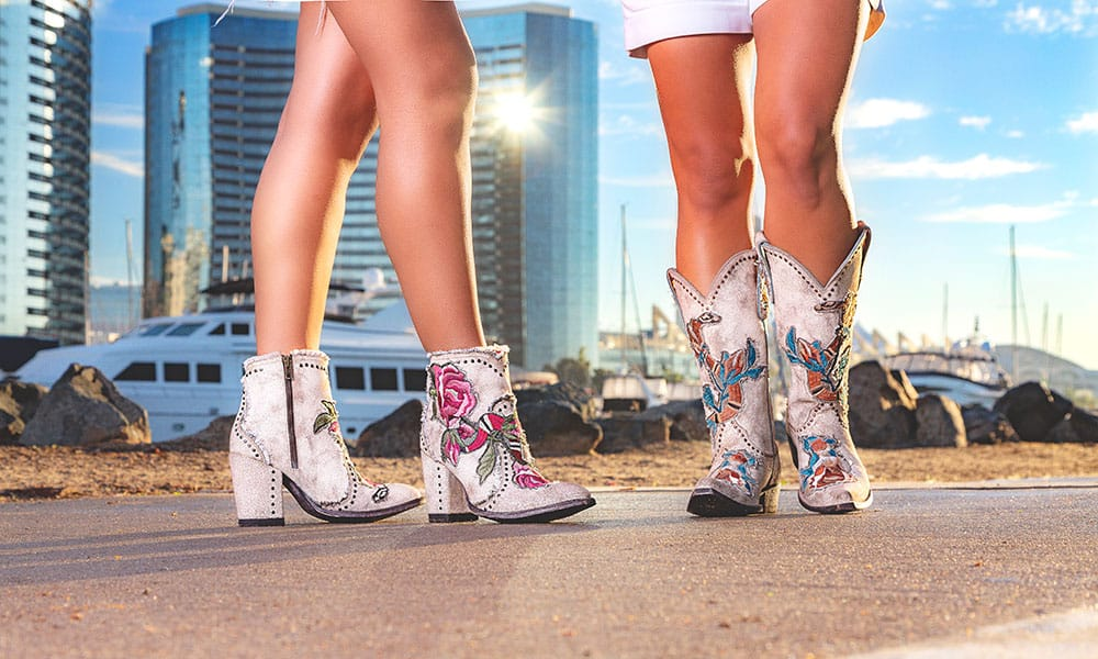 short white and tall white boots, with flowers in a city background