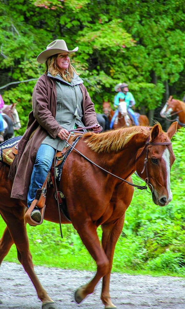 girl horse riding mackinac island michigan trails cowgirl magazine