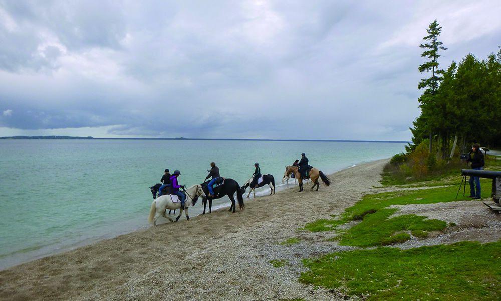 beach lake huron mackinac island michigan british landing park horse riding cowgirl magazine
