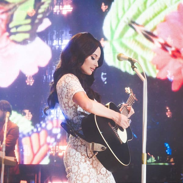 kacey musgraves cowgirl magazine houston livestock show and rodeo Houston rodeo concert Selena Michael Kors jumpsuit como la flor