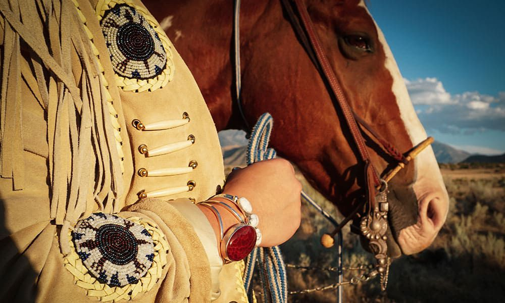 image of a cowgirl who doesn't fit in anymore with a horse