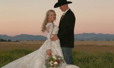bride with the sterling lane cierra frost chandelier earrings from Montana Silversmiths on her wedding day with her cowboy groom