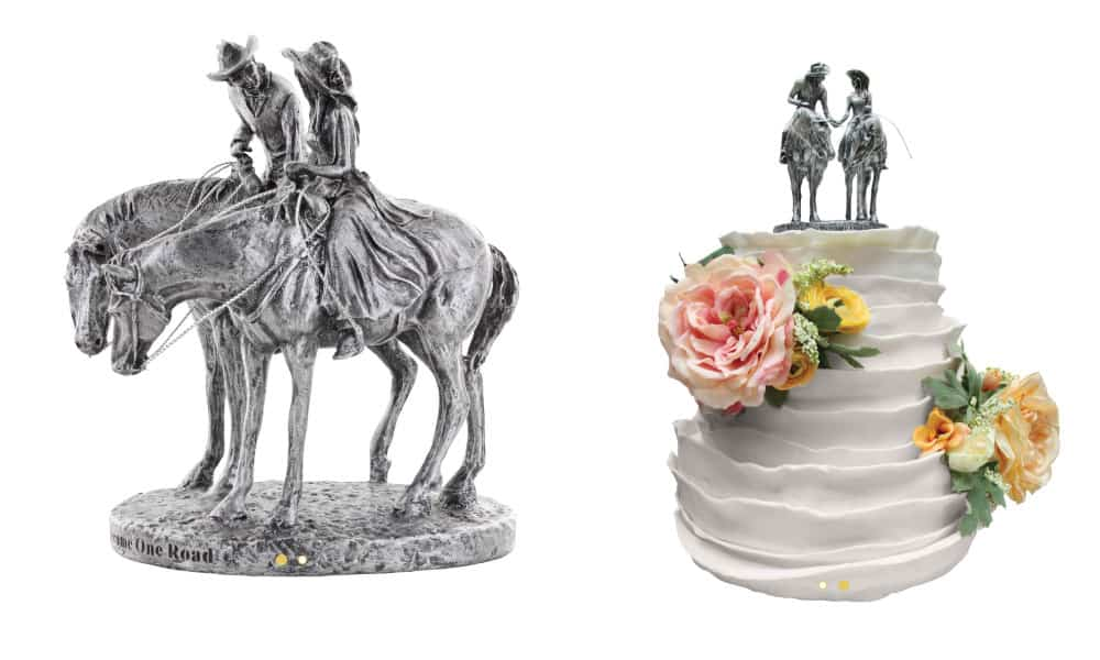 Cake topper with bride and groom on top of a wedding cake