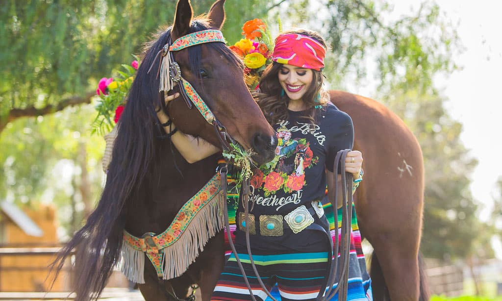 girl with horse and serape pants and belt from rodeo quincy