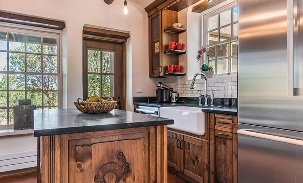 farmhouse sink in a wooden kitchen with a fridge cowgirl magazine