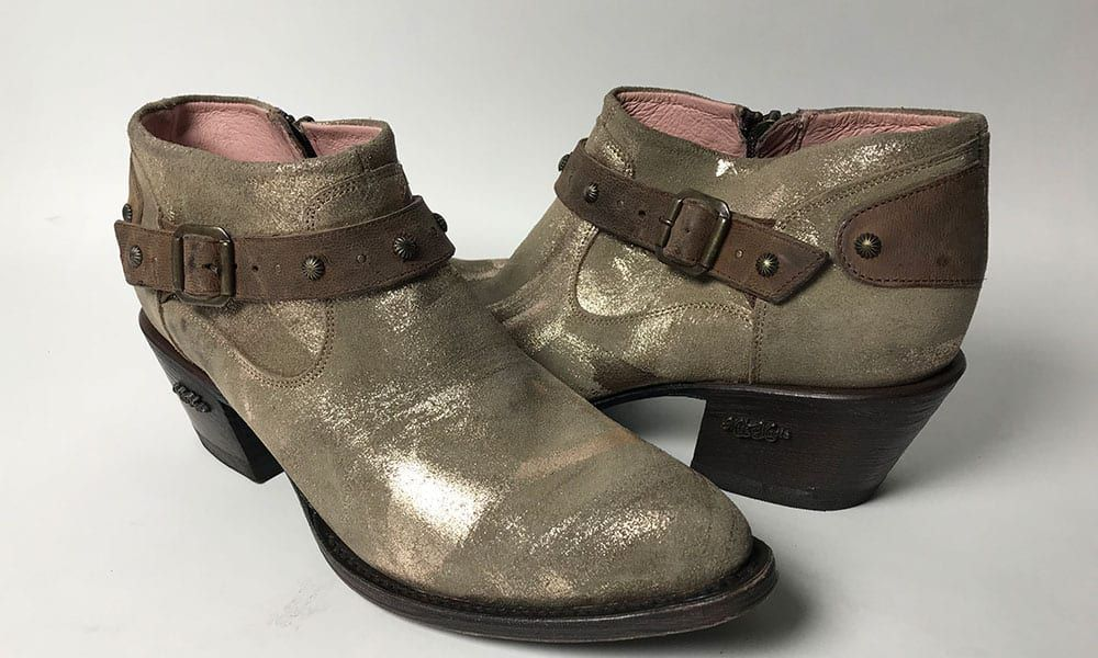 gold boots with brown strap and zipper