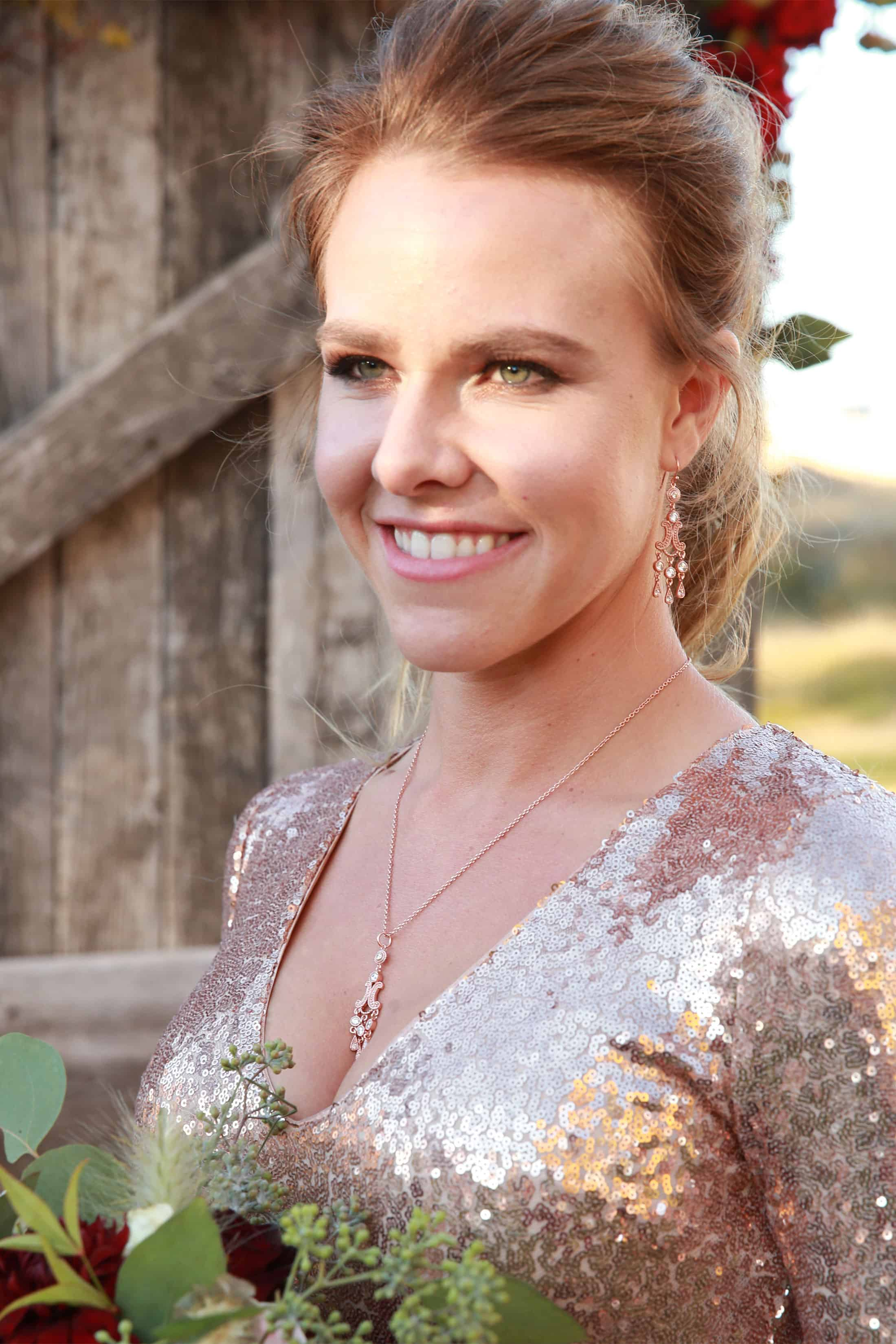 Rose gold necklace and earrings wedding set on a bride from Montana Silversmiths