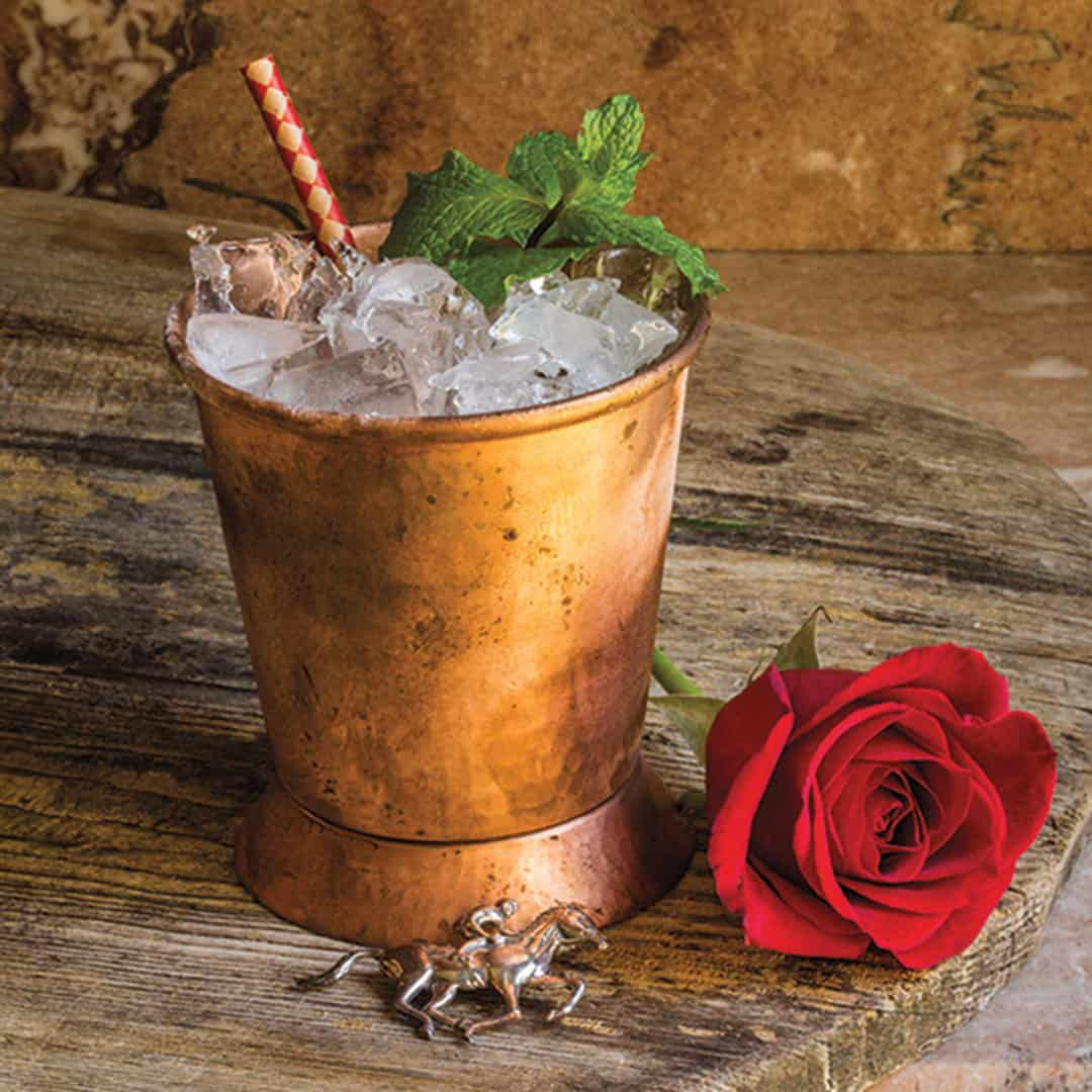 mint julep cocktail with rose cowgirl magazine