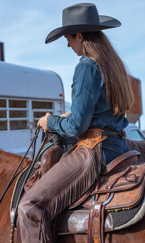 mesa pate in saddle on horseback cowgirl magazine