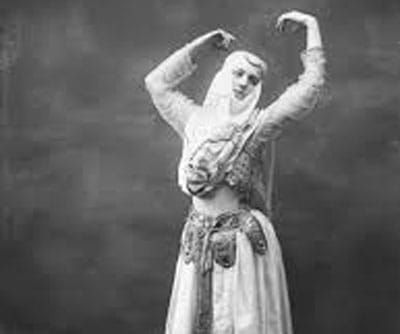 wild women of the west Klondike Dance Hall Girl dancing in a dress in the old west.