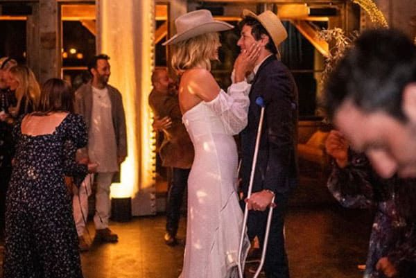 Karlie Kloss wears a wedding dress any cowgirl would dream of.