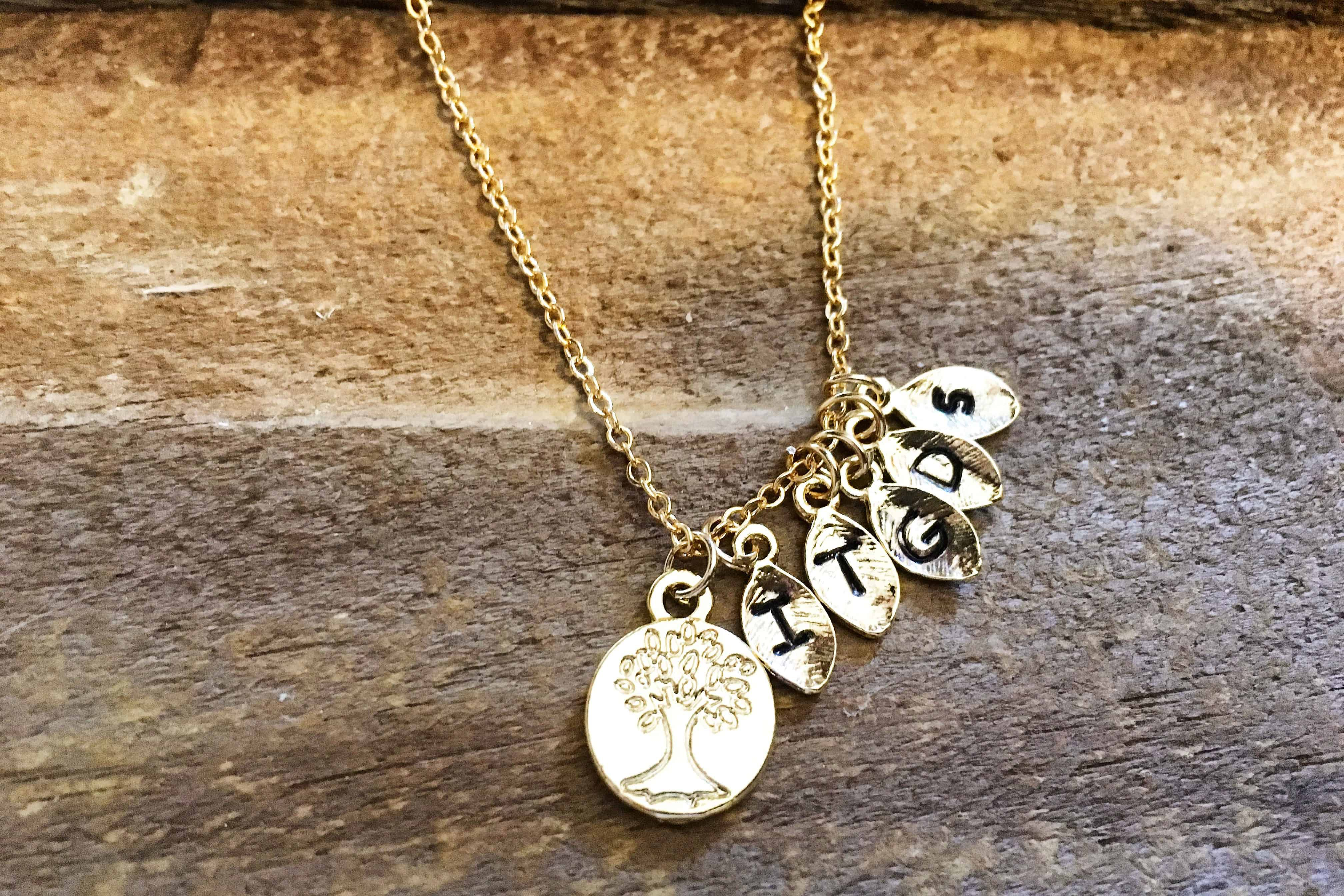 Family tree Gold necklace, starting at $17