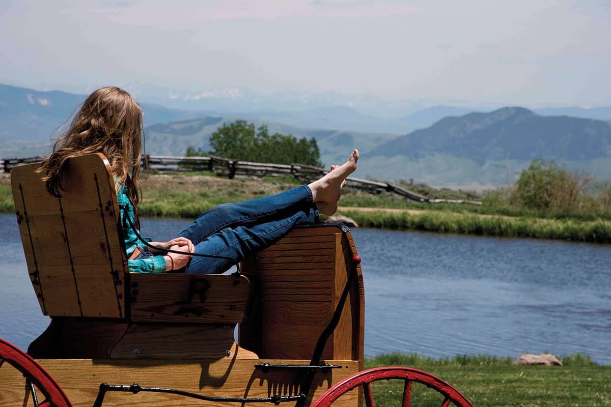 cowgirl looking at a lake latigo trails ranch kremmling colorado cowgirl magazine