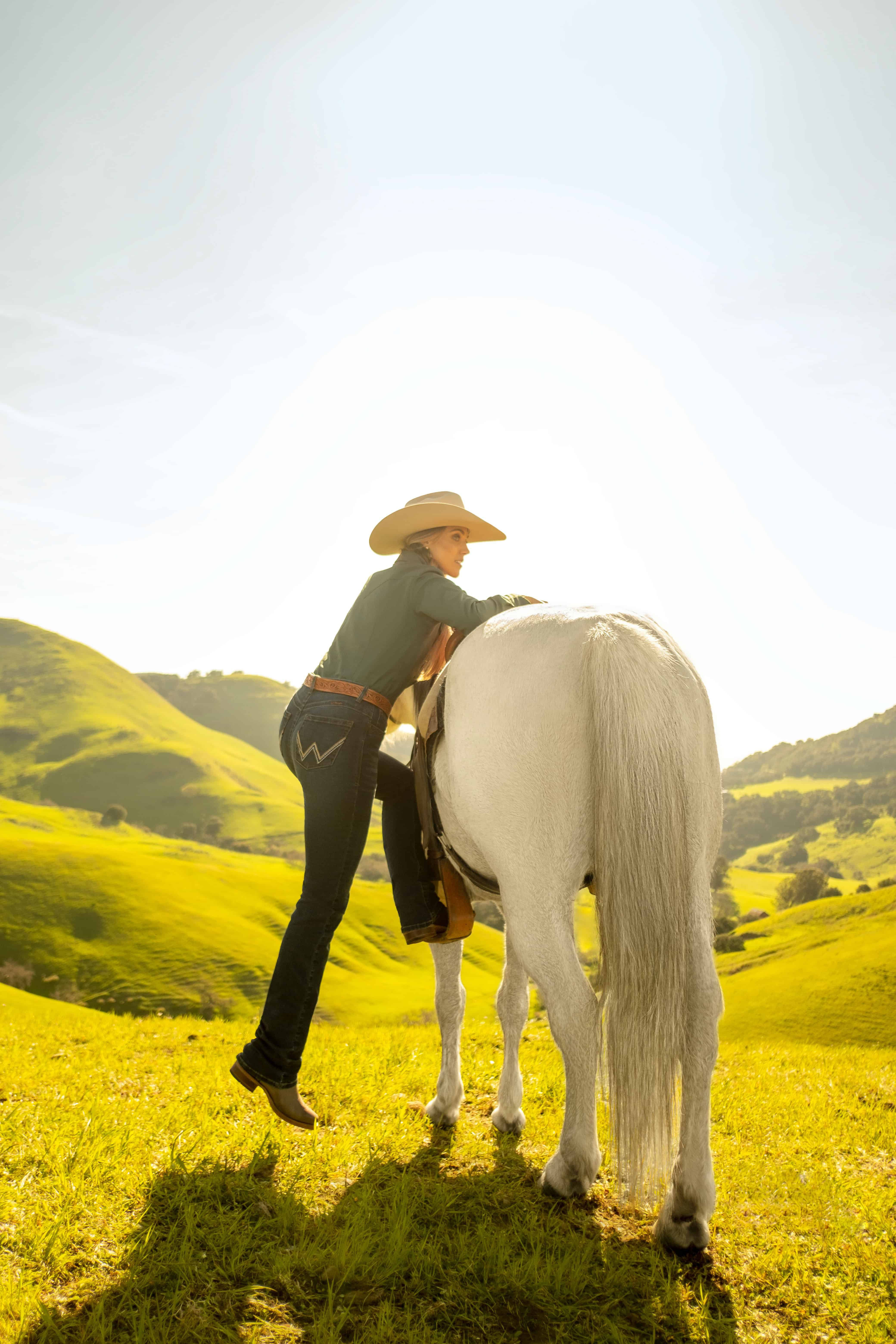 wrangler riding jean is perfect for functional cowgirl activities with a horse