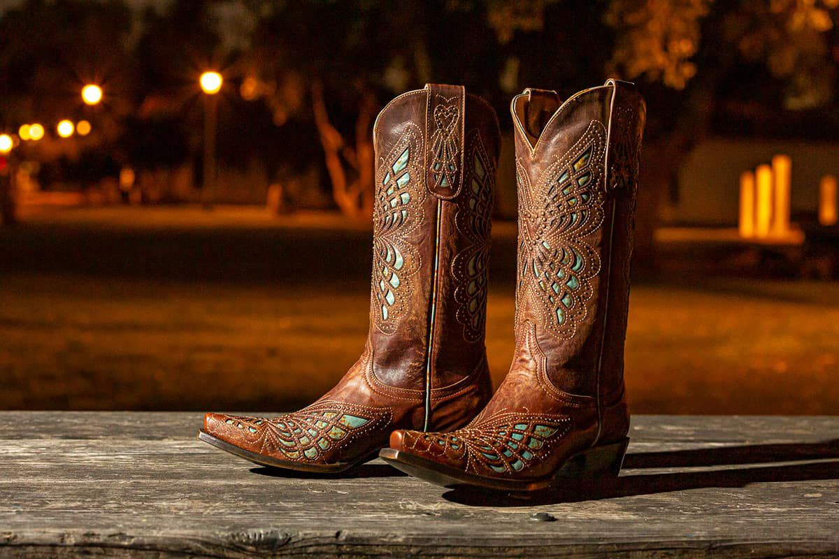 brown boots on wood floor cowgirl magazine