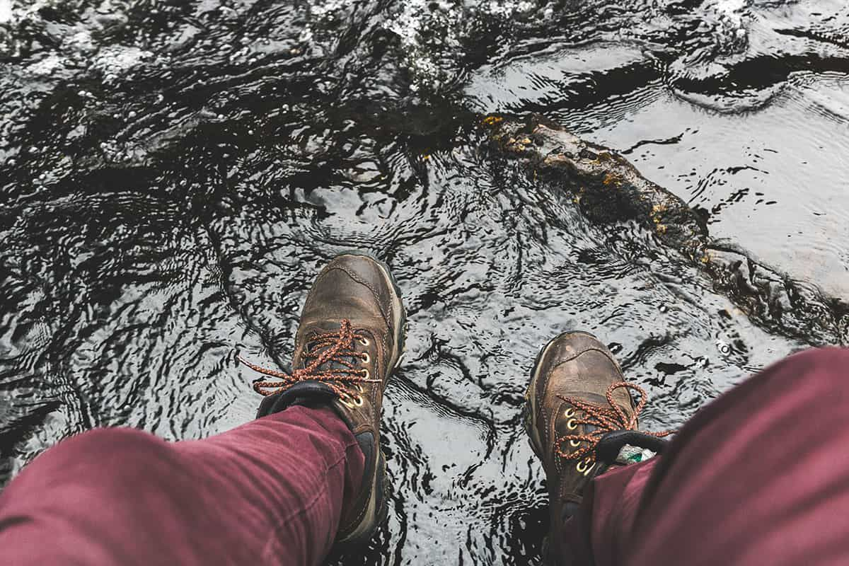 hiking boots on wet rock cowgirl magazine