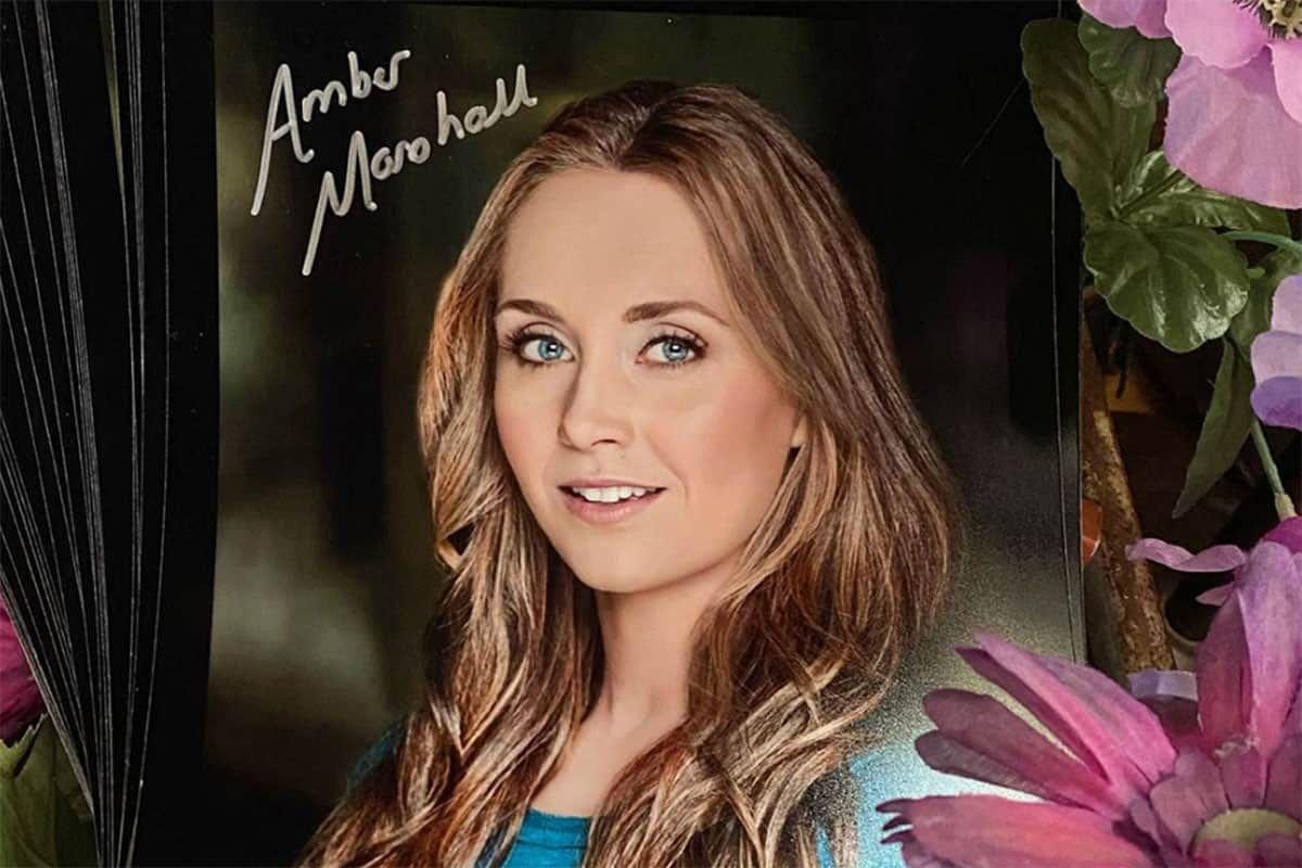 Amber Marsahall's signed headshots cowgirl magazine